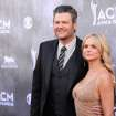 FILE - In this April 6, 2014 file photo, Blake Shelton, left, and Miranda Lambert arrive at the 49th annual Academy of Country Music Awards at the MGM Grand Garden Arena in Las Vegas.  Lambert's really going to need a break after an already hectic week that now includes plane troubles, and Shelton is prepared to provide her with one. Lambert was already neck deep in the busiest week of the year when things took a turn toward the scary Tuesday, June 3, 2014, as the private jet ferrying Lambert and her team from New York to Nashville was forced to make an emergency landing in Clarksburg, West Virginia.  (Photo by Al Powers/Powers Imagery/Invision/AP, file)