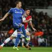 Chelsea's John Terry, left clears the ball as Arsenal's Olivier Giroud attempts to tackle during their English Premier League soccer match between Arsenal and Chelsea at the Emirates stadium in London, Monday, Dec 23, 2013. (AP Photo/Alastair Grant)