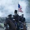This undated publicity photo provided by DreamWorks and Twentieth Century Fox shows Daniel Day-Lewis as President Abraham Lincoln looking across a battlefield in the aftermath of a terrible siege in this scene from director Steven Spielberg's drama