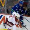 Vancouver Canucks' Alex Burrows, right, and Phoenix Coyotes' Zbynek Michalek, of the Czech Republic, collide during the second period of an NHL hockey game in Vancouver, British Columbia, on Sunday, Jan. 26, 2014. (AP Photo/The Canadian Press, Darryl Dyck)