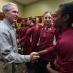 Former President George W. Bush shakes hands with Florida State's Morgan Tolels, right, and as Leonor Rodriquez watches before their second-round game against Baylor in the NCAA women's college basketball tournament, Tuesday, March, 26, 2013, in Waco, Texas. (AP Photo/Rod Aydelotte, Pool)