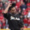 Miami Marlins' Edward Mujica reacts after giving up a home run to Cincinnati Reds' Jay Bruce in the eight inning of a baseball game in Cincinnati, Thursday, April 5, 2012. The Reds won 4-0. (AP Photo/Tom Uhlman)