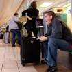 Blizzard conditions in Oklahoma City Thursday,  Dec. 24, 2009. Aukai dennis yawns while waiting to make flight changes after his flight to take him home to Hawaii for the holidays was cancelled.   He is stationed at Vance Air Force Base in Enid.   Photo by Jim Beckel, The Oklahoman