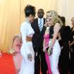 "Singer Rihanna, left, greets model Cara Delevingne, right, and actress Reese Witherspoon at The Metropolitan Museum of Art's Costume Institute benefit gala celebrating ""Charles James: Beyond Fashion"" on Monday, May 5, 2014, in New York. (Photo by Evan Agostini/Invision/AP)"