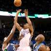 Oklahoma City's Russell Westbrook puts up a shot over Minnesota's Al Jefferson (left) and Damien Wilkins during their NBA basketball game at the Ford Center in downtown Oklahoma City on Sunday, April 4, 2010. The Thunder beat the Timberwolves 116-108. Photo by John Clanton, The Oklahoman ORG XMIT: KOD