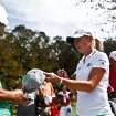 LPGA pro Stacy Lewis, right, signs autographs before she tees off during day two of pro-am action at the CME Group Titleholders on Wednesday Nov. 14, 2012, at Twin Eagles Golf Club in Naples, Fla. (AP Photo/Naples Daily News, Scott McIntyre) FORT MYERS OUT.