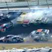 Michael Annett (43), Johanna Long (70), Hal Martin (44), Mike Bliss (19), Jason White (00), Joe Nemechek (87), Jeffrey Earnhardt (79), Matt Kenseth (18), Danny Efland (4) and Kasey Kahne (5) collide and slide as Austin Dillon (3) escapes between Turns 1 and 2 during the NASCAR Nationwide Series auto race at Daytona International Speedway in Daytona Beach, Fla., Saturday, Feb. 23, 2013. (AP Photo/Phelan M. Ebenhack)