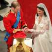 Britain's Prince William and his bride Kate Middleton exchange rings during their wedding service at Westminster Abbey, London, Friday April 29, 2011. (AP Photo/Andrew Milligan, Pool) ORG XMIT: RWBJ111