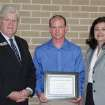 Moore Norman Technology Center Superintendent John Hunter (L) helps MNTC Instructor Charlotte Burnham (R) present Accounting student Steven Howard with the 2006 Nancy Liner Memorial Scholarship.  Community Photo By:  Trowbridge  Submitted By:  Anna,