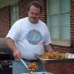 Marty Fry works the fryers at the Harrah United Methodist Church's first annual F3 Fry's Fish Fry on May 7. On the menu were catfish, french fries, fried sweet potatoes, two kinds of coleslaw, hush pupppies and chicken bites. Dessert was homemade apple pies baked by members. Proceeds from the supper will go towards a new sign and parking lot for the church. Fry and his wife, the former Kathy Helm, plan to make the fish fry an annual event.  Community Photo By:  Lin Archer  Submitted By:  Lin,