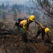 U.S. Forest Service fire crew members Madison Hampton, left, and Robert Keck, from Plumas National Forest, work north of Highway 50 near Kyburz, Calif. on Tuesday, July 9, 2013. More than 800 personnel are working a wildland blaze today near Kyburz that is 40 percent contained. Despite progress overnight, the fire burning near Kyburz in the Eldorado National Forest is still restricting travel through the Sierra on Highway 50.  (AP Photo/The Sacramento Bee, Randall Benton)  MAGS OUT; LOCAL TV OUT (KCRA3, KXTV10, KOVR13, KUVS19, KMAZ31, KTXL40); MANDATORY CREDIT