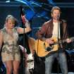 Recording artists Miranda Lambert, left, and Dierks Bentley perform at the 55th annual Grammy Awards on Sunday, Feb. 10, 2013, in Los Angeles. (Photo by John Shearer/Invision/AP) ORG XMIT: CASH143