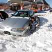 David Rogers digs snow away from his wife's car so it can be removed after being abandoned in deep snow yesterday. His wife is a customer service representative at the downtown bus transfer station on N. Hudson. She made it just a short distance after leaving work before her car became stuck. Many spent Christmas Day, Dec. 25, 2009,  digging out from record snow storm that dumped 14 inches of snow in the Oklahoma City area.   Photo by Jim Beckel, The Oklahoman