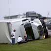 Northbound traffic passes a truck that was blown over during a storm on I-35 near  Hillsdale Free Will Baptist College in Norman on Monday, May 10, 2010. By John Clanton, The Oklahoman