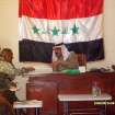 Ahmed Abdullah, second from left, talks with the city council chairman in Ishaqi, Iraq.  PROVIDED - Provided
