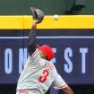 The Philadelphia Phillies Marlon Byrd just misses a ball that went for a double by Atlanta Braves Justin Upton during the second inning of a baseball game on Sunday, July 20, 2014, in Atlanta.(AP Photo/Atlanta Journal-Constitution, Curtis Compton)