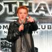 In this Dec. 16, 2012 photo, teenage comedian Eric Kurn performs his stand-up act during the