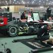Mechanics from the IndyCar team Penske work in the garage area of the race track in Sao Paulo, Brazil, Thursday, May 2, 2013.  Brazil will host the 4th race of the Indy Car season on May 5. (AP Photo/Andre Penner)