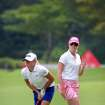 Stacy Lewis, left, and Paula Creamer, right, from the United States compete on the 6th fairway during the final round of the HSBC Women's Champions golf tournament on Sunday, March 3, 2013, in Singapore. (AP Photo/Wong Maye-E)