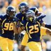 West Virginia's Pat Miller (6) celebrates Darwin Cook's (25) interception as Will Clarke (98) watches during their NCAA college football game against Baylor in Morgantown, W.Va., Saturday, Sept. 29, 2012. (AP Photo/Christopher Jackson)   ORG XMIT: WVCJ107