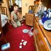 Mary Reneau talks with her husband on the telephone while she looks at the floor of her dining room, now littered with broken china, glassware and other sentimental keepsakes that were damaged when  tossed to the floor during an earthquake in the early morning hours of Saturday, Nov. 5. , 2011.  Doors of her furniture flew open and drawers were edged slightly open during the quake.  Mary and her husband, Joseph were awakened around 2:15 a.m. when their house shook and items began falling off the walls and form shelves and cabinets inside their two-story brick ranch-style  home in rural Lincoln County, about  six miles northwest of Prague.  Austin Holland, a seismologist with the Oklahoma Geological Survey, placed the quake's epicenter within two to three miles of the Reneau home.  The Reneaus have lived in their house for 25 years. Photo by Jim Beckel, The Oklahoman  ORG XMIT: KOD