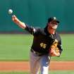CORRECTS DAY AND DATE - Pittsburgh Pirates pitcher Gerrit Cole throws against the St. Louis Cardinals in the first inning of Game 2 of baseball's National League division series on Friday, Oct. 4, 2013, in St. Louis. (AP Photo/Elsa, Pool)