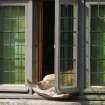 A dog sleeps in the sun,  along the old canals in Bruges, Belgium, Friday, March 29, 2013. Low temperatures are predicted for the upcoming Easter weekend in large parts of Europe. (AP Photo/Yves Logghe)