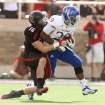 Texas Tech's Cody Davis tries to drag down Kansas' James Sims during their NCAA college football game in Lubbock, Texas, Saturday, Nov. 10, 2012. (AP Photo/Lubbock Avalanche-Journal, Zach Long) LOCAL TV OUT