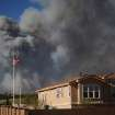 The Black Forest Fire burns northeast of Colorado Springs, Colo, Tuesday, June 11, 2013. The fire burned several homes and forced the evacuation of thousands of people. (AP Photo/Bryan Oller)