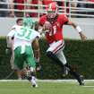Georgia quarterback Aaron Murray (11) runs for a first down as North Texas cornerback Kenny Buyers (31) pursues in the first half of an NCAA college football game at Sanford Stadium Saturday, Sept. 21, 2013, in Athens, Ga. (AP Photo/Atlanta Journal-Constitution, Jason Getz )  MARIETTA DAILY OUT; GWINNETT DAILY POST OUT; LOCAL TV OUT; WXIA-TV OUT; WGCL-TV OUT