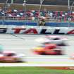 In this image taken with a slow shutter speed, drivers practice for Sunday's Aaron's 499 NASCAR auto race at Talladega Superspeedway on Friday, May 2, 2014, in Talladega, Ala. (AP Photo/Rainier Ehrhardt)