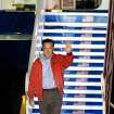 Republican presidential candidate, former Massachusetts Gov. Mitt Romney, waves towards a camera platform after exiting his MD-83 campaign plane at the Shenandoah Valley Regional Airport Sunday evening Oct. 7, 2012 in Weyers Cave, Va. Romney completed a three day campaign swing through Florida and will deliver a foreign policy address at the Virginia Military Institute in Lexington Monday. (AP Photo/Daily News-Record, Michael Reilly)