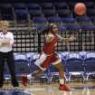 Oklahoma's Aaryn Ellenberg passes the ball up the court while Oklahoma head women's basketball coach Sherri Coale, left, leads practice before the NCAA basketball tournament in Durham, N.C., Friday, March 21, 2014.  Oklahoma faces DePaul in the first round on Saturday.  (AP Photo/Ted Richardson)