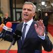 Swiss President and OSCE chairperson in office Didier Burkhalter gestures as he talks with the media, after he met with EU foreign ministers, at the European Council building in Brussels, Monday, May 12, 2014.  European Union foreign ministers are considering adding more people to its Ukraine sanctions list but are not expected to go beyond visa bans and asset freezes before the May 25 elections in the east European nation. (AP Photo/Yves Logghe)