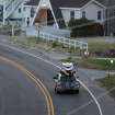 A car loaded down with bikes, kayaks and surfboards heads north on NC 12 through Buxton on Hatteras Island, N.C., at dawn on Thursday, July 3, 2014.  The island is under a mandatory evacuation order because of approaching Hurricane Arthur.   (AP Photo/The Virginian-Pilot,Steve Earley)   MAGS OUT