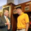COLLEGE FOOTBALL / OSU: Oklahoma State University head football coach Mike Gundy, right talks with T. Boone Pickens in the locker room during a tour of the west end zone of Boone Pickens Stadium's facilities in Stillwater, Oklahoma August 17, 2009.They are standing in front of T. Boone Pickens' locker.  Photo by Steve Gooch, The Oklahoman ORG XMIT: KOD