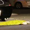 In this image provided by KEYT-TV, a body is covered on the ground after a mass shooting near the campus of the University of Santa Barbara in Isla Vista, Calif., Friday, May 23, 2014.  A drive-by shooter went on a