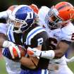 Duke's Conner Vernon score a touchdown past Virginia's Brandon Phelps (21) and Maurice Canady (26) during an NCAA college football game Saturday, Oct. 6, 2012, in Durham, N.C. (AP Photo/The Herald-Sun, Bernard Thomas)