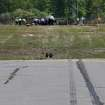 Skid marks are seen on the runway at the scene Monday, June 2, 2014, in Bedford, Mass., where a plane plunged down an embankment and erupted in flames during a takeoff attempt at Hanscom Field Saturday night. Lewis Katz, co-owner of The Philadelphia Inquirer, and six other people died in the crash. (AP Photo/Boston Herald, Mark Garfinkel, Pool)