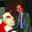 Oklahoma City University President Tom McDaniel visits with Santa at the university's Light the Campus celebration last week. The university invited its neighbors to a Hanging of the Greens ceremony and a Holiday Fun Fest last Wednesday for the annual Light the Campus event.  Community Photo By:  Leslie Berger/OCU News Services  Submitted By:  Leslie, Oklahoma City