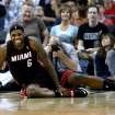 Miami Heat forward LeBron James reacts after falling to the ground during the second half of an NBA basketball game against the New Orleans Pelicans in New Orleans, Saturday, March 22, 2014. The Pelicans won 105-95. (AP Photo/Jonathan Bachman)