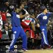 Los Angeles Clippers forward Ronny Turiaf of France, from left, DeAndre Jordan and Blake Griffin react to a teammate's dunk in the second half of an NBA basketball game on Monday, Jan. 14, 2013, in Memphis, Tenn. The Clippers won 99-73. (AP Photo/Lance Murphey)