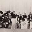 Miguelito, center,  playing trumpet, with his orchestra in Puerto Rico. Miguelito and Olga Miranda married five months ago and are beginning a life together as husband and wife after a nearly 70 year separation.  Miguelito and Olga were neighbors in Puerto Rico and childhood sweethearts, described by both as the other's