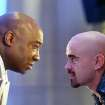 In this undated movie still provided by Twentieth Century Fox, the crime lord Kingpin, played by Michael Clarke Duncan, left, hires Bullseye, played by Colin Farrell, in a scene from the movie