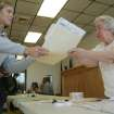 Katie Miller, left, receives a ballot and instructions from Sally Hughes at a polling station at the Galena City Hall in Galena, Kan., on Tuesday Nov. 6, 2012. (AP Photo/The Joplin Globe, Roger Nomer)