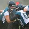 Rain splashes off of Luke Joeckel, left, as he pushes and shoves with Ryan Davis (59) during a drill at the NFL football team's rookie minicamp, Saturday, May 4, 2013, in Jacksonville, Fla. (AP Photo/The Florida Times-Union, Bruce Lipsky)
