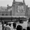 FILE - In this May 1, 1963 file photo, a Naval rocket is exhibited in Moscow's Red Square past a banner of Vladimir Lenin, Friedrich Engels and Karl Marx during the annual May Day parade in the Soviet Union. Under the shadow of the Cold War's threat of