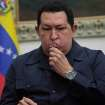 ALTERNATIVE CROP OF XFLL103,- In this photo released by Miraflores Press Office, Venezuela's President Hugo Chavez kisses a crucifix during a televised speech form his office at Miraflores Presidential palace in Caracas, Venezuela, Saturday, Dec. 8, 2012. Chavez announced Saturday night that his cancer has returned and that he will undergo another surgery in Cuba. Chavez, who won re-election on Oct. 7, also said for the first time that if his health were to worsen, his successor would be Vice President Nicolas Maduro.(AP Photo/Miraflores Press Office, Marcelo Garcia)