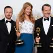 """Aaron Paul, left, poses with the award for outstanding supporting actor in a drama series, with Anna Gunn, center, with the award for outstanding supporting actress in a drama series, and Bryan Cranston with the awards for outstanding lead actor in a drama series and outstanding drama series for """"Breaking Bad"""" in the press room at the 66th Annual Primetime Emmy Awards at the Nokia Theatre L.A. Live on Monday, Aug. 25, 2014, in Los Angeles. (Photo by Jordan Strauss/Invision/AP)"""