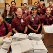 Members of the Integris Baptist Medical Center maintenance crew pose for a photo on Monday, Dec. 3, 2007, in Oklahoma City, Okla. with the more than 4000 letters they have collected for injured soldiers at Walter Reed Army Medical Center.    Photo By CHRIS LANDSBERGER, The Oklahoman